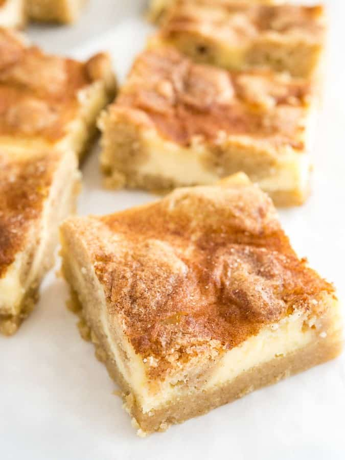 Snickerdoodle Cheesecake Bars are the best of both worlds! With a creamy cheesecake top and a soft cinnamon-sugary snickerdoodle bottom, these bars are to die for!