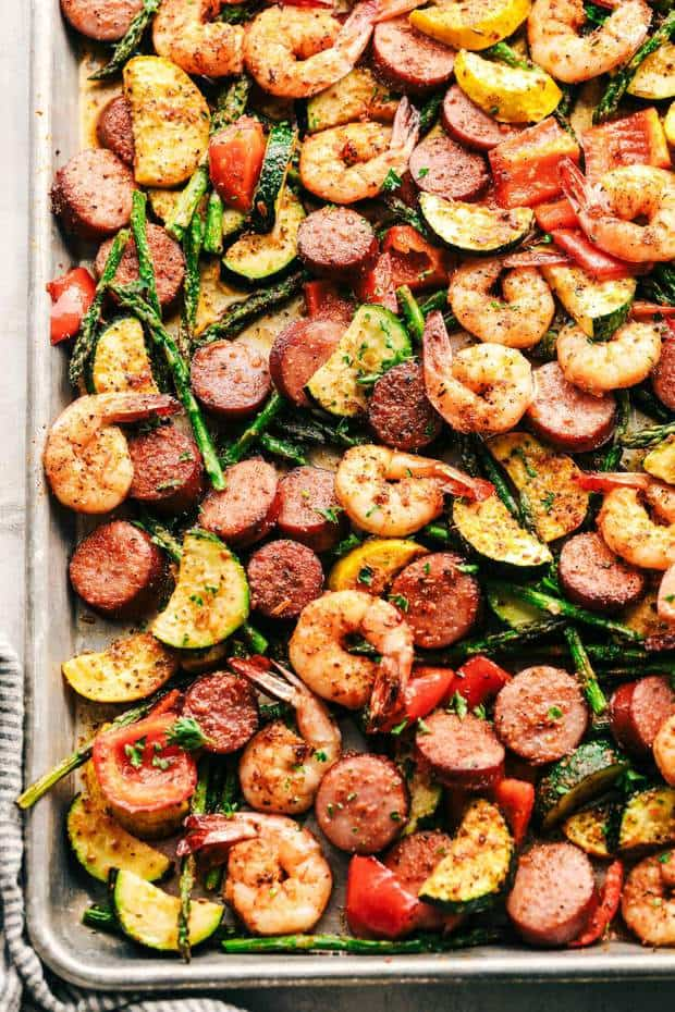 Cajun Shrimp and Sausage Vegetable Sheet Pan is so incredibly easy but packed with such amazing cajun flavor!  This is a healthy and delicious meal that is also great for meal prep!