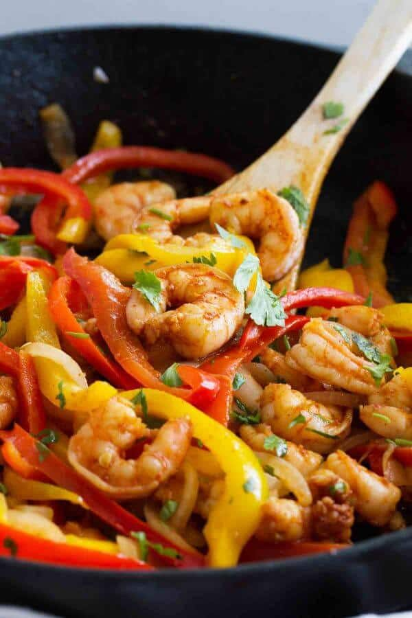 Dinner in a jiffy – these Skillet Shrimp Fajitas are not only good for you, but can be done in under 30 minutes! Peppers, onions and fajita spiced shrimp are all cooked in one skillet for an easy dinner.