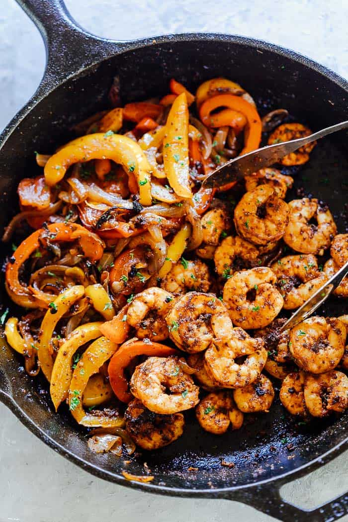 Made with a homemade fajita seasoning and wrapped in tortillas, these quick shrimp fajitas are the perfect weeknight meal!