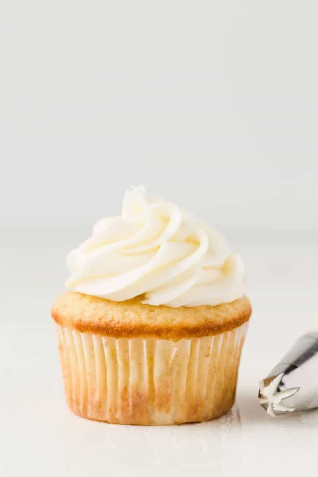 There's nothing better than this recipe for homemade Coconut Buttercream Frosting. It's a made from scratch, simple recipe that is perfect slathered on cakes, cupcakes, or right from the spoon.