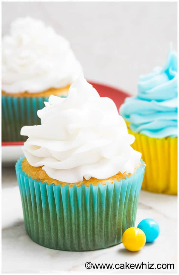 This quick and easy 2 ingredient white chocolate buttercream frosting is rich, creamy and fluffy. It's great for piping cupcakes and frosting cakes.