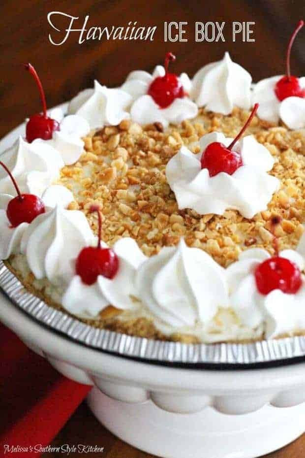 This Hawaiian Ice Box Pie recipe from Melissa's Southern Style Kitchen is the perfect no-bake ice box pie that is packed with flavors that will make you think you're on vacation to a tropical island paradise! It's easy to make, perfect for parties and tastes amazing!