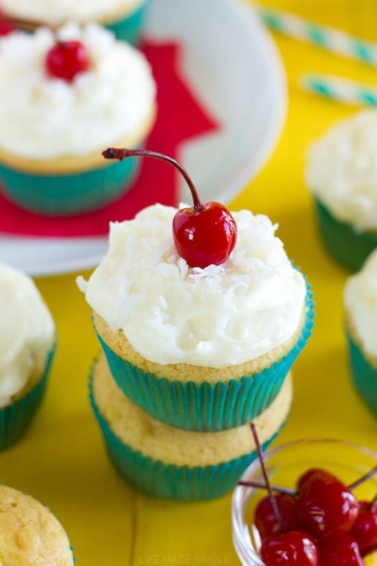 TheseSweet Piña Colada CupcakesfromLife Made Simpleare filled with pineapple and topped with a light and fluffy pineapple coconut cream cheese frosting. They are so delicious and taste like there's a little bit of summer in each bite!