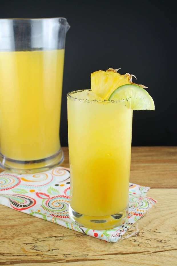 Pineapple Margaritas are a fun twist on my favorite classic party cocktail.  Sweet pineapple with a bit of orange and a twist of lime!