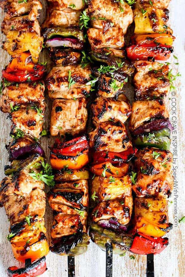 These Grilled Hawaiian Chicken Kabobs from Spend with Pennies have tender juicy chicken layered with a rainbow of veggies in a tangy Pineapple Honey BBQ Sauce.  They make the perfect quick & easy summer meal that your friends and family will really love!
