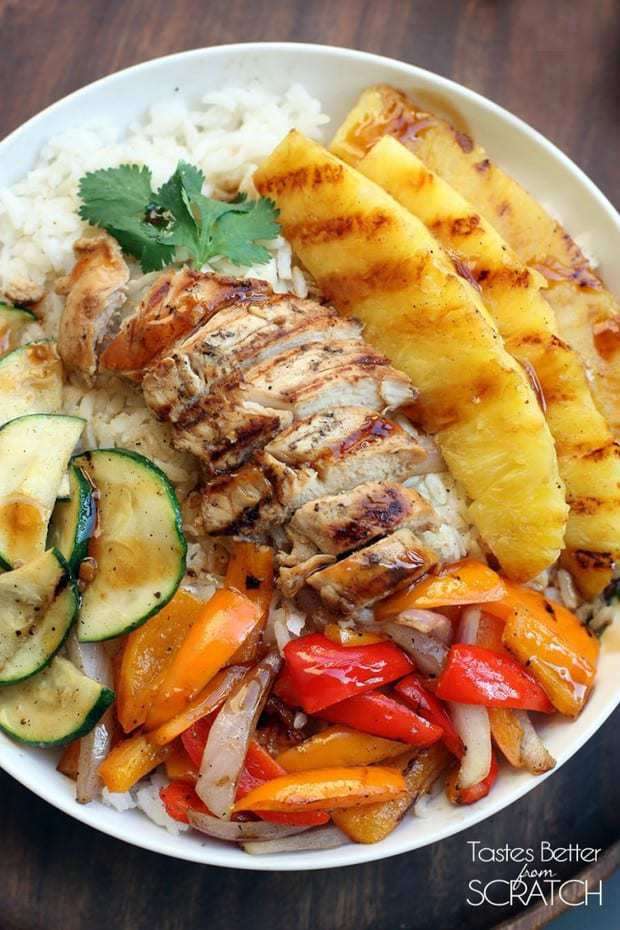 To make these Grilled Hawaiian Chicken Teriyaki Bowls from Tastes Better from Scratch you combine a few of our very favorite things like homemade coconut rice, homemade teriyaki sauce, veggies, and grilled pineapple. Once you put each of those tasty items together you've created pure magic! A little bit of sweet, a little bit of tangy and spicy and smokey all at the same time!