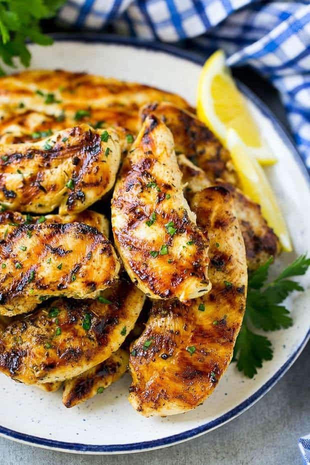 Grilled chicken tenders are marinated in lemon, garlic, herbs and olive oil, then grilled to golden brown perfection. The ultimate easy main course for summer time!