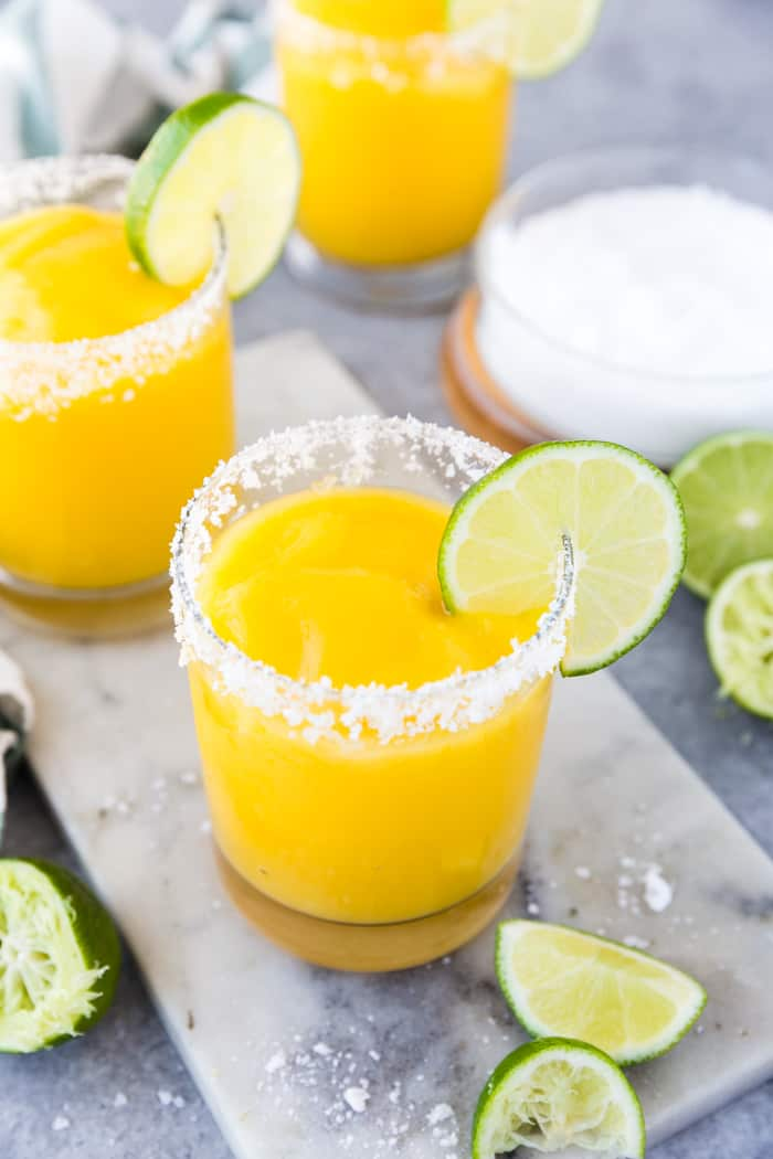 Delicious and easy to make frozen Mango Margaritas are tart, sweet, easy to customize, and are the perfect cocktail recipe to keep you cool this summer.