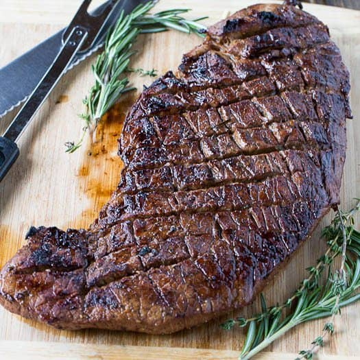 Grilled London Broil is juicy and flavorful and cooks in just a matter of minutes. Making shallow cuts on each side of the meat helps it cook up just right and lets the flavor of the marinade really get into the meat.