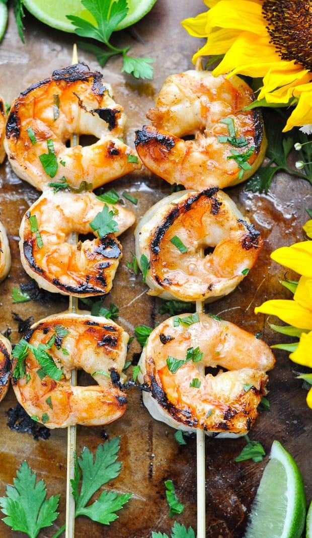 A simple Marinated Grilled Shrimp recipe is the perfect easy and healthy dinner for warm weather months! With just 10 minutes of prep and 5 minutes on the grill, this fresh dish comes together quickly and makes family meals relaxing, delicious, and nutritious!