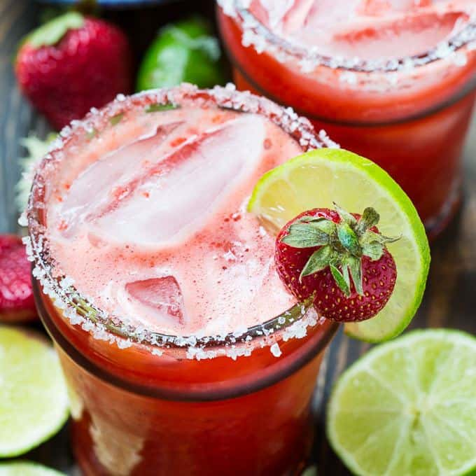 Homemade Strawberry Margaritas made from fresh strawberries, lime juice, agave, tequila, and Triple Sec make a cool and refreshing cocktail that's perfect for getting a spring or summer weekend started.