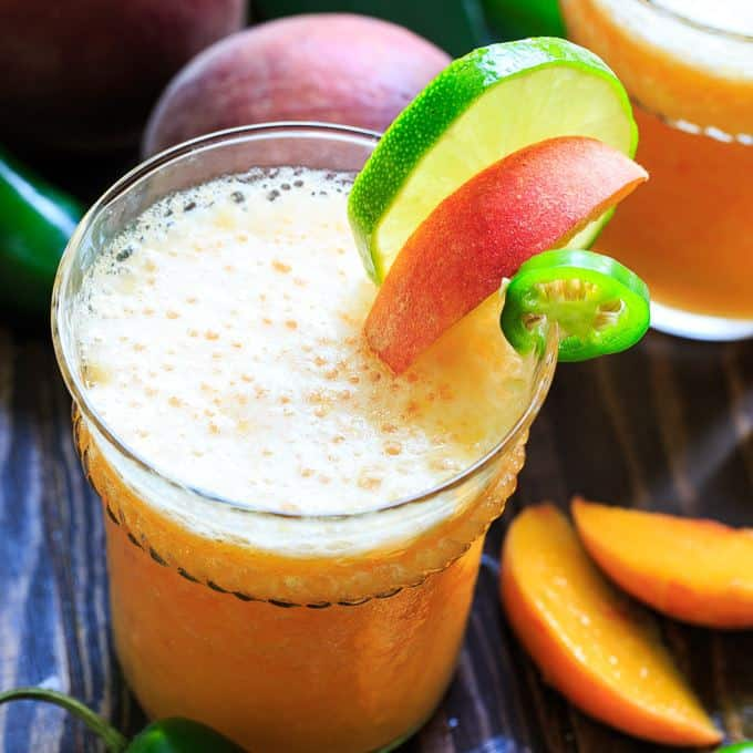 Peach Jalapeno Margaritas are made for summer. They are both sweet and spicy and make a refreshing cocktail for warm weather.