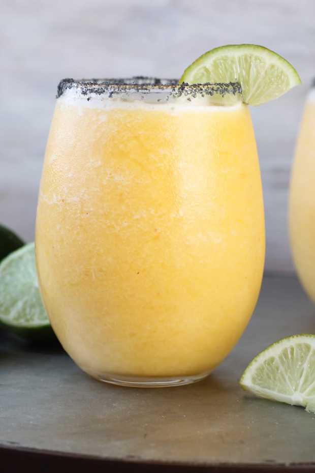 Frozen Peach Margaritas are the perfect refreshing cocktail. Simple and easy with just a few ingredients, perfect for parties and weekend get togethers with friends.