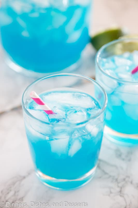 Blue Margarita Recipe – A pretty blue twist on a classic margarita. So easy to make, delicious, and fun to drink. You can make it by the glass or by the pitcher!