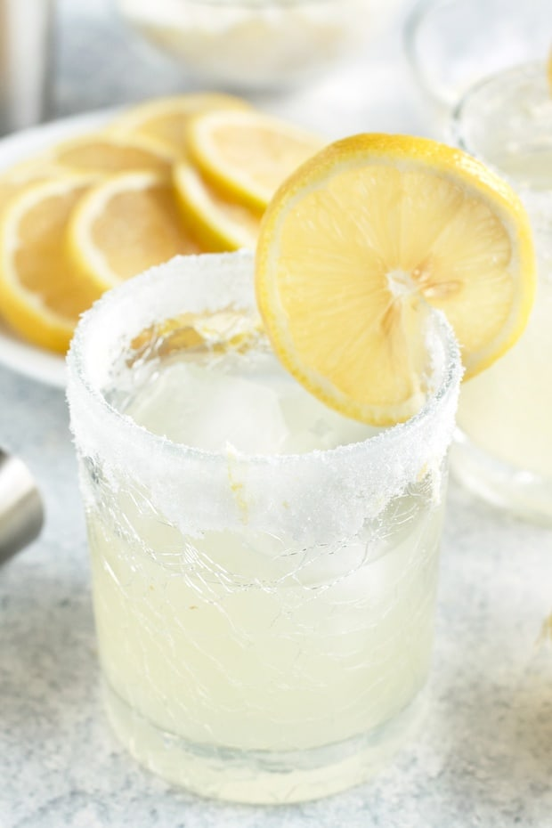 A Lemon Agave Margarita is a bright and citrusy take on the classic margarita, but without that pesky over-sweetened margarita mix. Made with fresh lemon juice and agave, this margarita is fresh and vibrant. Plus it can be rimmed with salt OR sugar, depending on your mood!