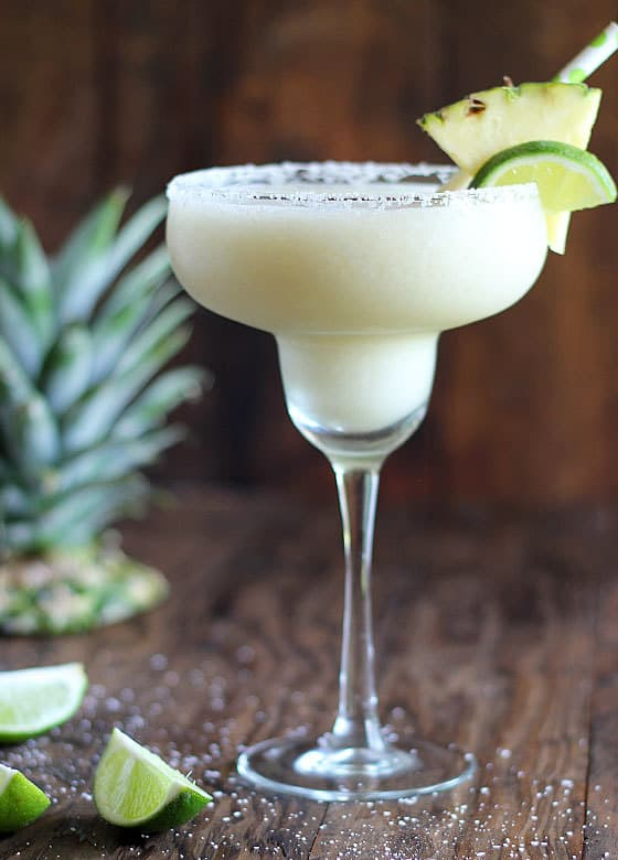 Oh. My. Word. This Frozen Coconut Pineapple Margarita is going to be your new go-to frozen margarita… and it's SO EASY!