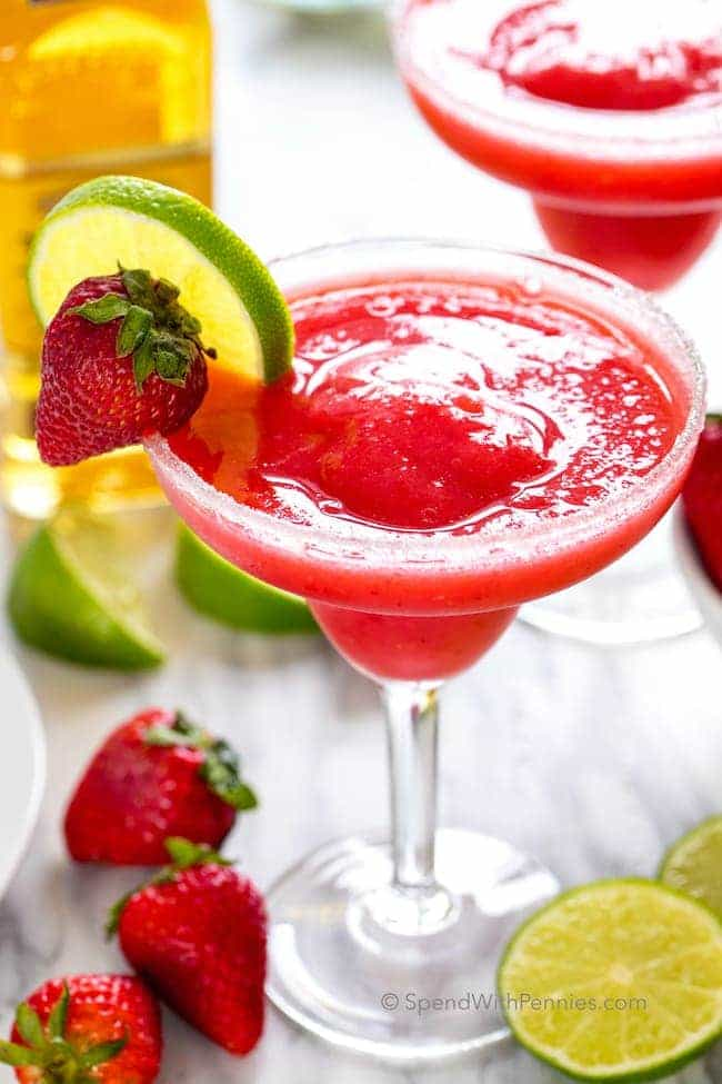 Refreshingly cool and incredibly frosty, Strawberry Margaritas are my go to summer drink! All you need are a few simple ingredients and a blender.  Once blended you can enjoy these right away or store them in the freezer as a make ahead cocktail that's ready when you are!