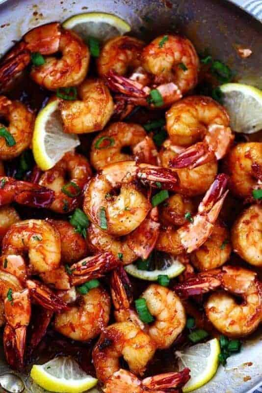 Sticky Honey Garlic ShrimpfromThe Recipe Criticare coated in the most amazing stick honey garlic butter soy sauce.It coats the shrimp perfectly and creates such a flavorful and sticky sauce! This is a quick 20 minute meal that you will make again and again!