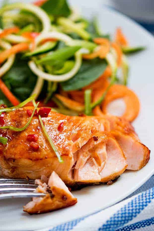 This Honey Garlic Baked Salmon from Simply Stacie uses a quick marinade, then 15 minutes in the oven, and you've got a super healthy delicious dinner that everyone will eat right up! The honey-garlic flavor means it's even a total hit with picky eaters too!