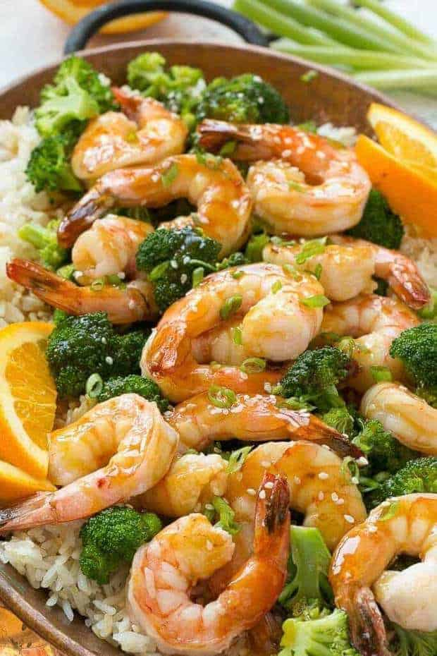 ThisOrange Shrimp and Broccoli with Garlic Sesame Fried Ricerecipe fromDinner at the Zoois the perfect quick and easy meal for a busy weeknight — or for entertaining guests. The sweet and tangy orange sauce only has 4 ingredients and the garlic sesame fried rice elevates the dish into something special!