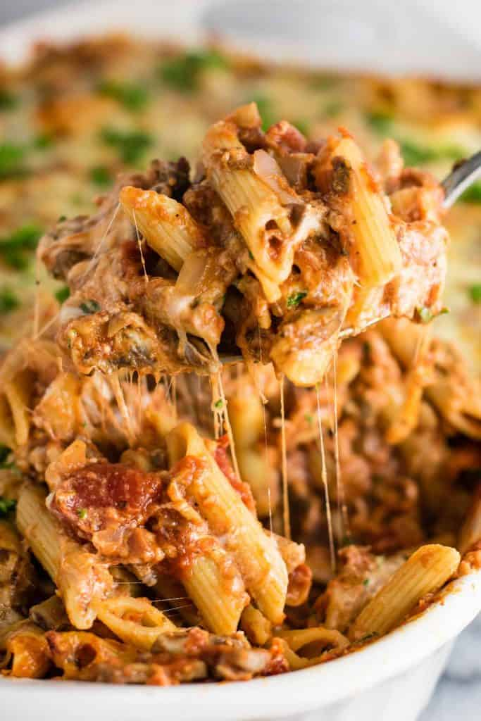 "This Meatless Million Dollar Baked Ziti is a lightened up take on the classic comfort food. Full of ""meaty"" mushrooms and four types of cheeses, your family will love this meatless baked ziti!"