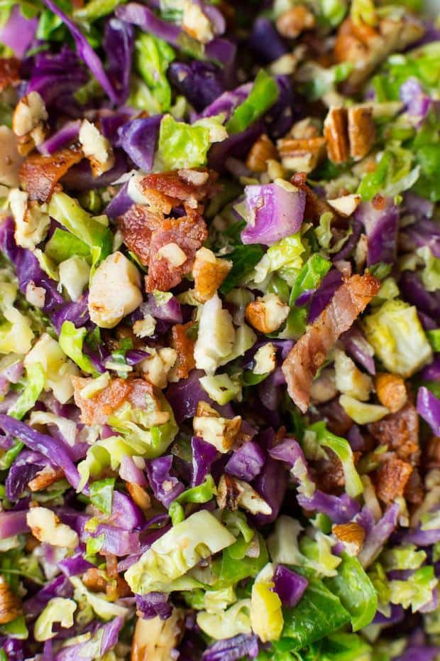 Shredded Brussels sprouts and chopped cabbage salad topped with crispy bits of bacon and chopped pecans | Gluten Free + Whole30  + Low Carb