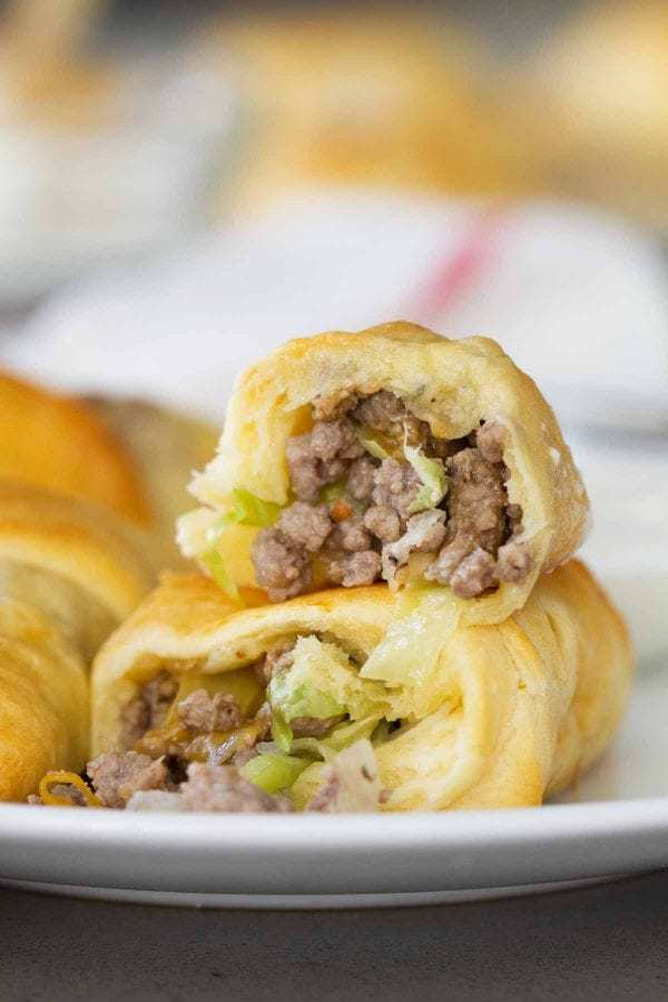 Super simple, yet super tasty, these Cabbage and Beef Bundles take a simple cabbage and beef filling and stuff it inside crescent rolls. Don't skip the horseradish mayo for dipping!