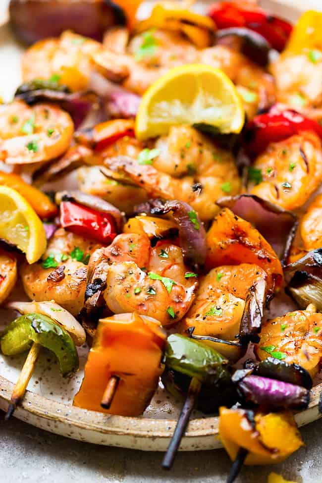 Grilled Lemon Garlic Shrimp Skewers with Vegetables - a simple and tasty recipe perfect for summer grilling. Juicy shrimp and tender veggies are coated in an amazing buttery lemon garlic blend that are grilled to perfection.