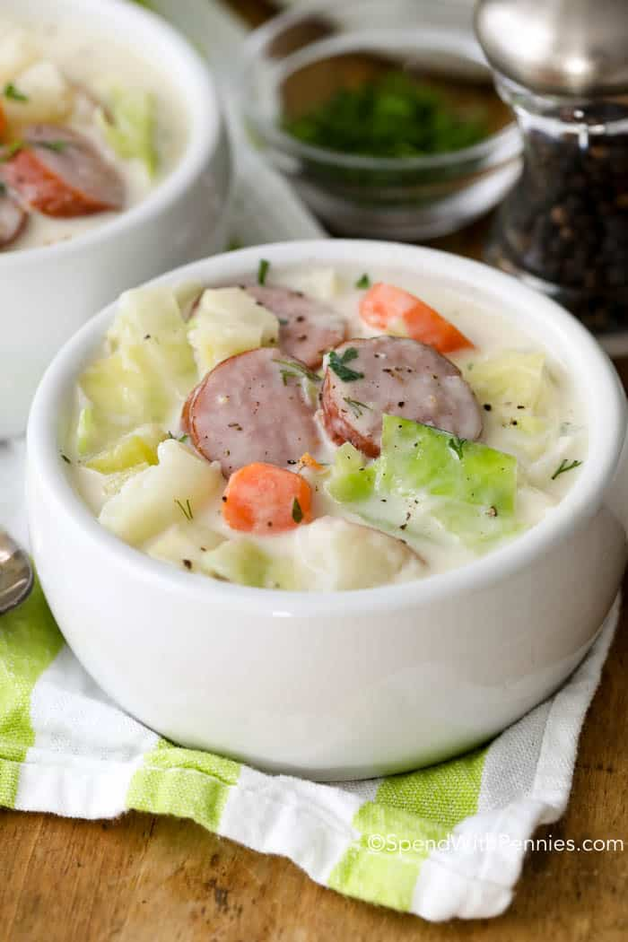 This easy Sausage & Cabbage Soup is the ultimate comfort food. A beautifully luscious soup with smoky sausage, fresh vegetables and of course sweet tender cabbage simmered in a flavorful creamy broth.