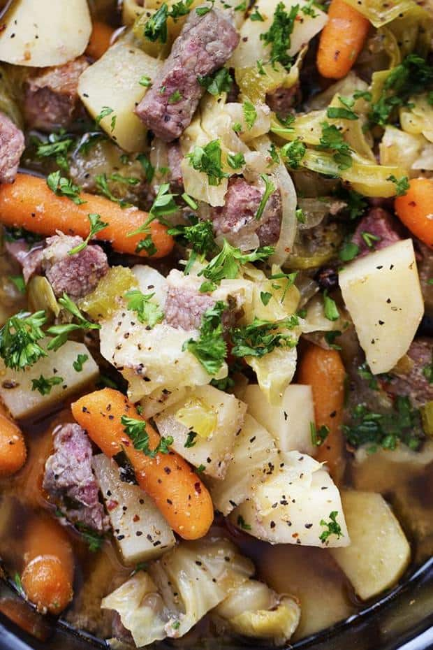Corned Beef and Cabbage slow cook all day with hearty vegetables making one delicious stew!  The McCormick spices also add such amazing and unique flavors!