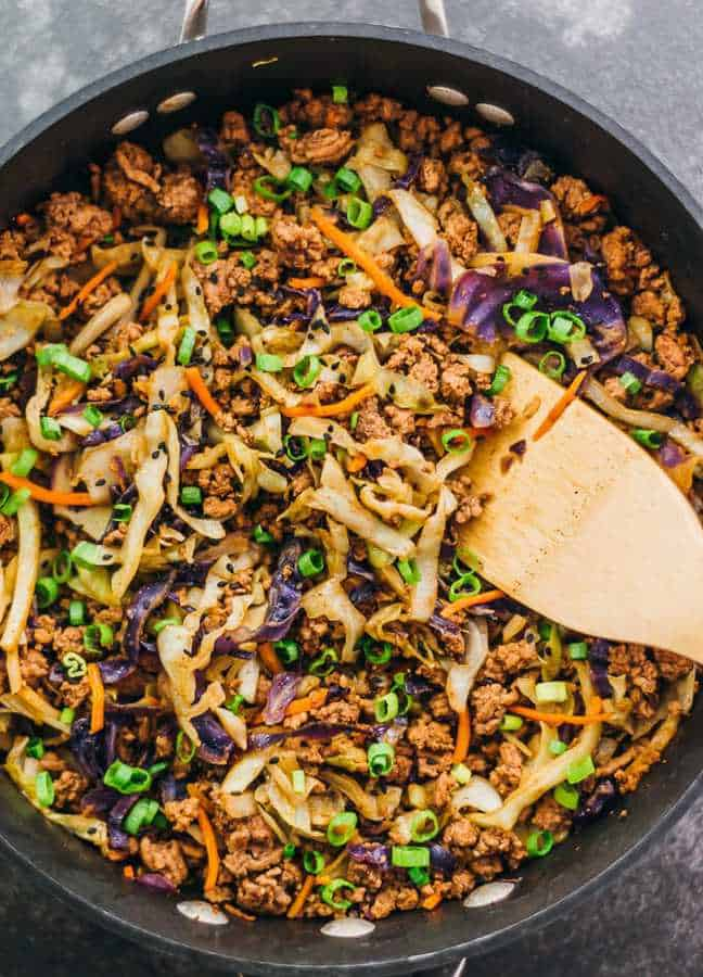 This super fast and easy stir fry dinner has ground beef with cabbage, carrots, and scallions.