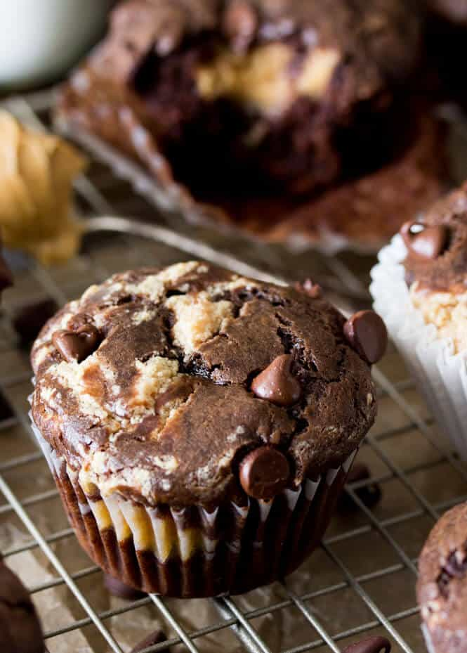 The ultimate in muffin decadence: Peanut butter filled chocolate muffins. These simple, double-chocolate muffins are studded with semisweet chocolate chips and filled with a surprise peanut butter cheesecake filling. Can you think of a better way to start the day?