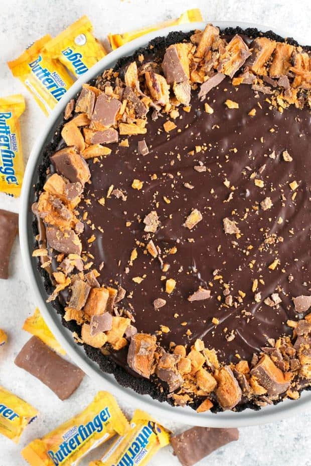 An Easy Butterfinger Caramel Ganache Tart is just the dessert to wow the crowd at your next football party. It's a deceptively simple yet totally drool worth indulgence that's perfect for pairing with beers or bourbon/whiskey. With only 5 steps, it's the low maintenance chocolate dessert you've been searching for!