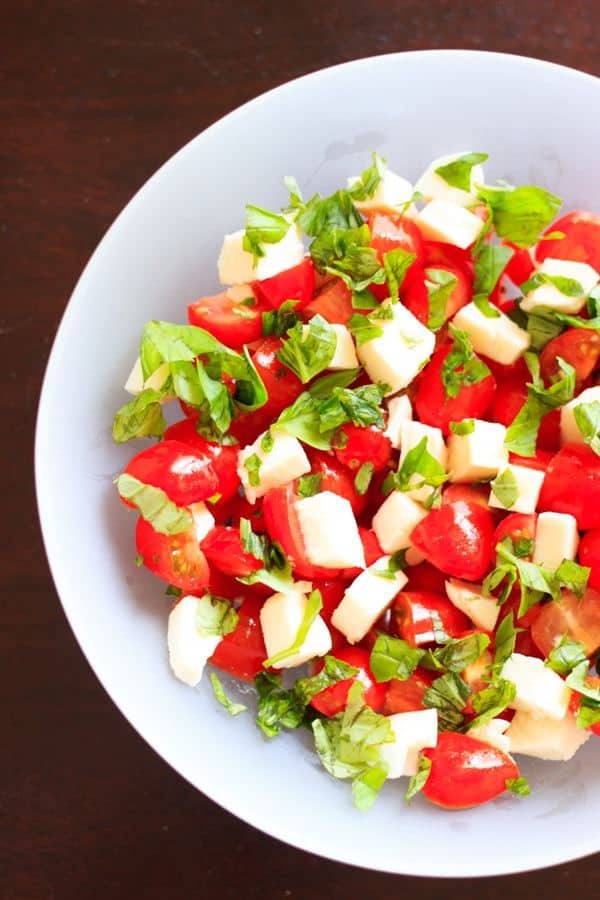 Chopped Caprese salad that takes 10 minutes and 5 ingredients to make. An easy way to enjoy this delicious gluten-free appetizer any time you want! This fresh salad will keep you coming back for more.