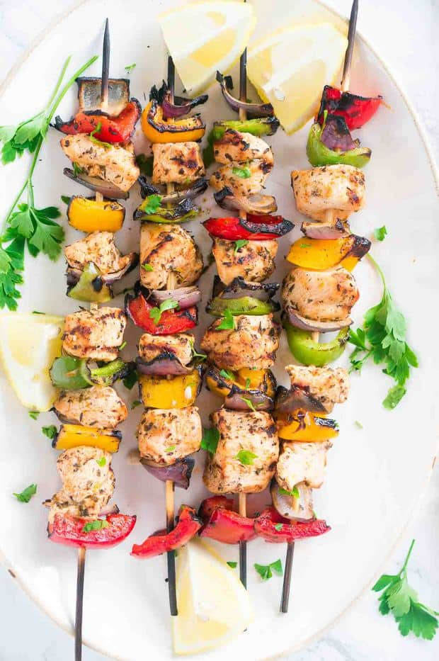 These Grilled Mediterranean Chicken Kebabs are full of flavor, and so easy to make either on the grill or in the oven. Chicken and fresh summer vegetables are marinated in a light Mediterranean-style marinade of lemon juice, olive oil, garlic, and spices, then grilled on skewers until golden brown. Delicious and healthy summer meal.