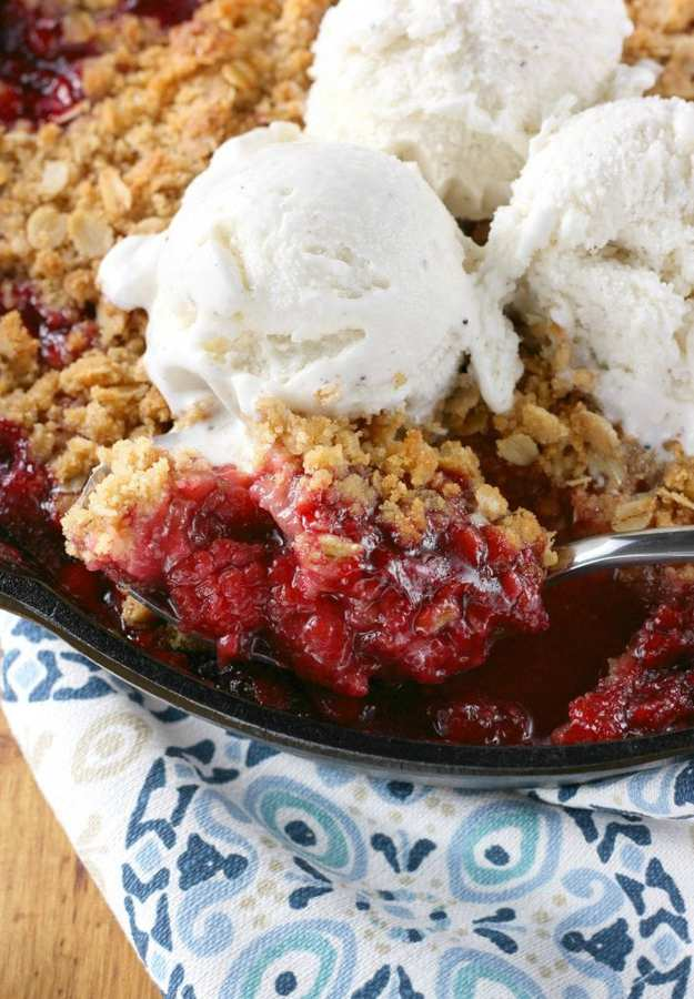 Fire up the grill and make this easy Grilled Skillet Raspberry Crisp! This recipe showcases sweet summer raspberries that are combined with a bit of sugar, cinnamon and lemon zest and topped with a rich, buttery streusel! Serve with a big scoop of ice cream to create an irresistible summer dessert!