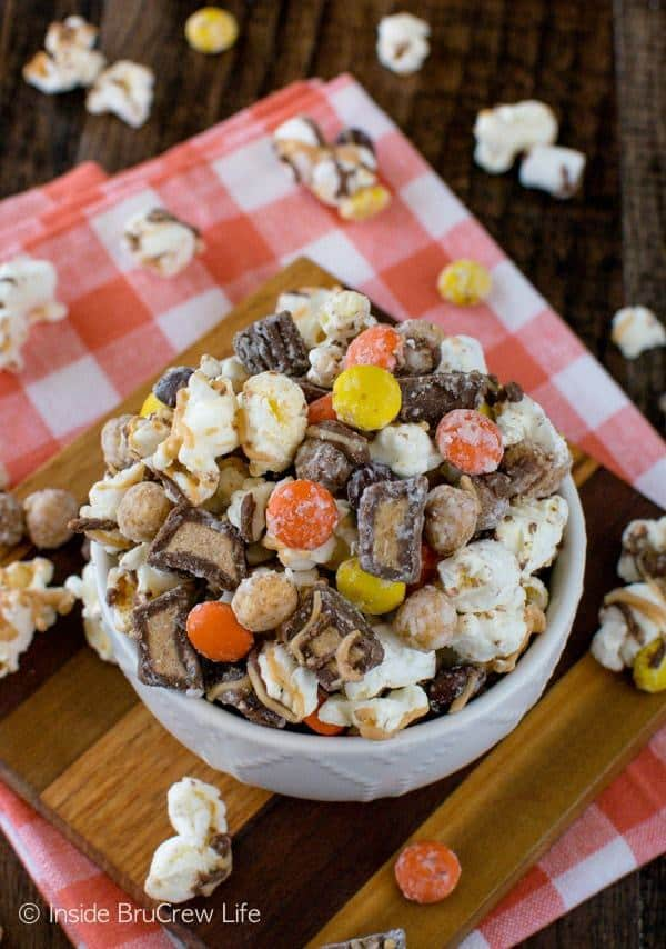 Three kinds of peanut butter goodness makes this Reese's Popcorn an unforgettable snack mix.  It's great for munching on for movie nights or for packaging in gift bags for holiday presents.