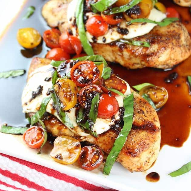 Grilled Chicken Caprese Recipe with Balsamic Sauce is so easy to make and so fresh and flavorful!  The charred smoky flavor from grilling the chicken takes this classic flavor combo to a whole natha' level!