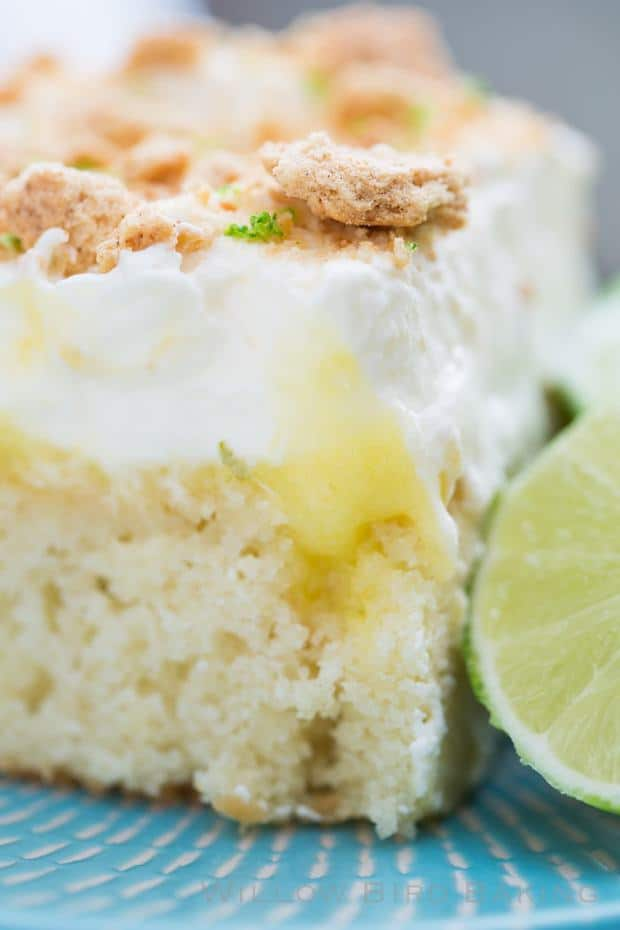 If you love key lime pie but want a little more substance or a bigger dessert to feed a crowd, this cake is perfect for you! This Key Lime Pie Sheet Cake features a moist yellow cake soaked in tart and sweet lime curd, frosted with fluffy whipped cream, and topped with crushed graham crackers.