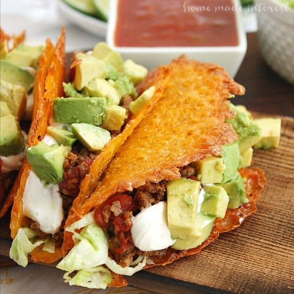 Have a low carb taco night with these Cheese Taco Shells made from baked cheddar cheese formed into the shape of a taco! It's an easy keto dinner recipe you're going to love!