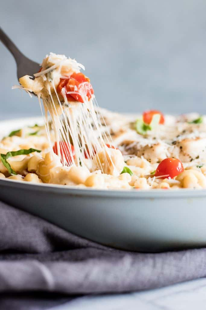 Chicken Caprese Mac and Cheese. A quick and easy one pot creamy mac and cheese loaded with juicy chicken, fresh tomatoes and basil.