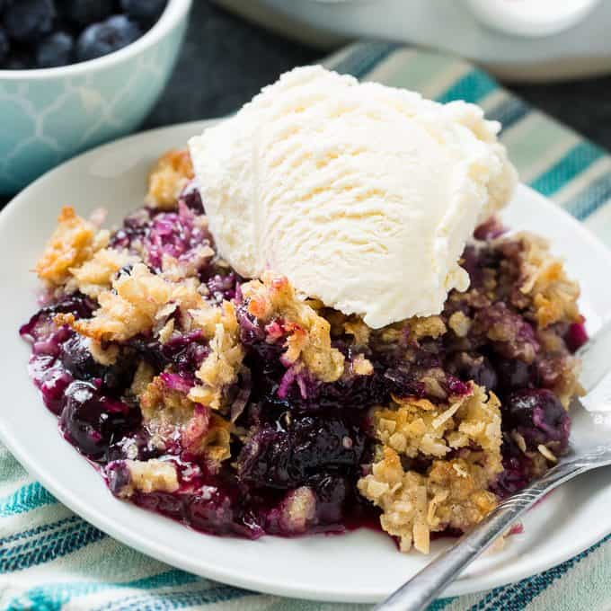 Blueberry Coconut Crisp is made from fresh blueberries covered in a sweet topping made from shredded coconut, oats and a hint of cinnamon. Serve warm with ice cream for an easy and delicious summer dessert.