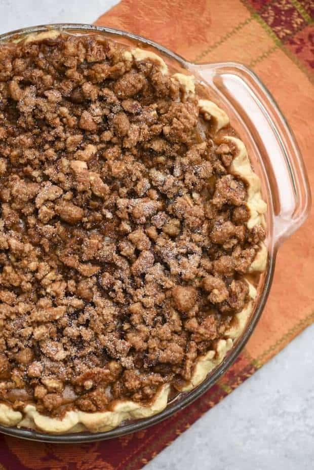 A richly spiced pumpkin custard layer is topped with a sticky sweet pecan praline and baked to perfection. This Praline Pumpkin Pie takes this Thanksgiving standard to a delicious new level!