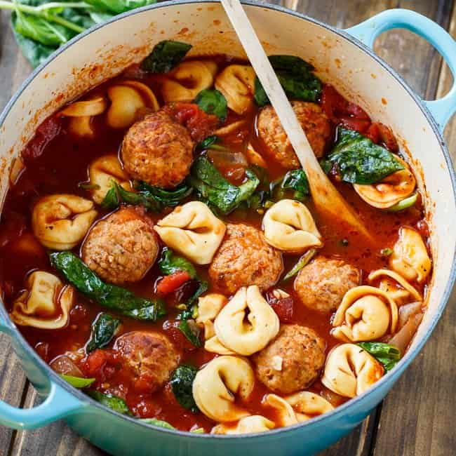 Meatball and Tortellini Soup is a hearty soup full of Johnsonville Italian-style meatballs and cheese tortellini plus some fresh spinach in a tomato broth. Using frozen,  pre-cooked meatballs is a great way to cut down on cooking time and get supper on the table in a hurry.