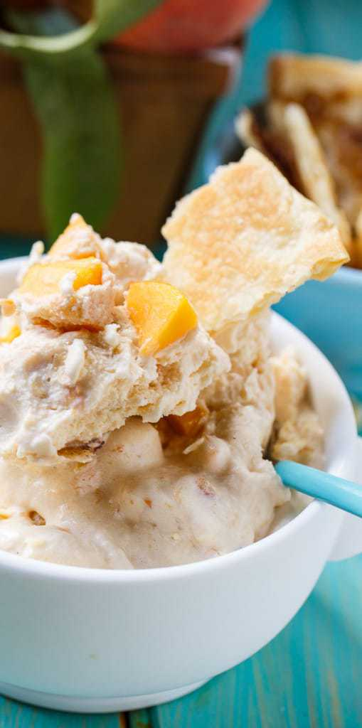 A creamy and rich ice cream with all the flavors of Peach Cobbler. This Peach Cobbler Ice Cream is a delicious summertime treat that is a perfect way to use fresh summer peaches.