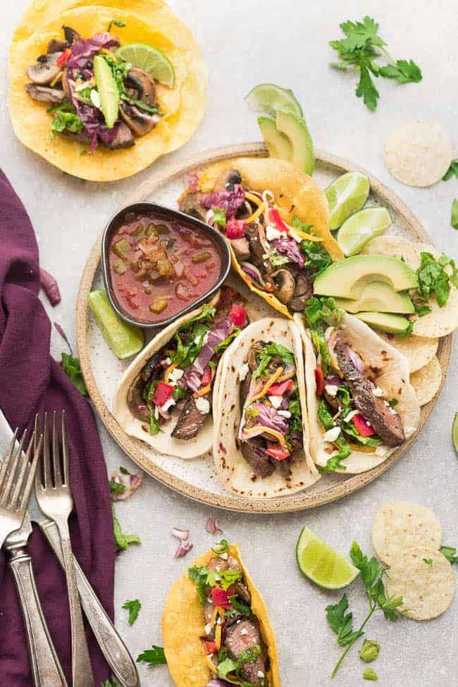 Chili Lime Steak Tacos are full of flavor and loaded with all the classic taco-truck toppings. Best of all, this recipe can be made on the grill or a skillet and the steak is perfectly tender, juicy and perfect for Cinco de Mayo or your next Taco Tuesday.