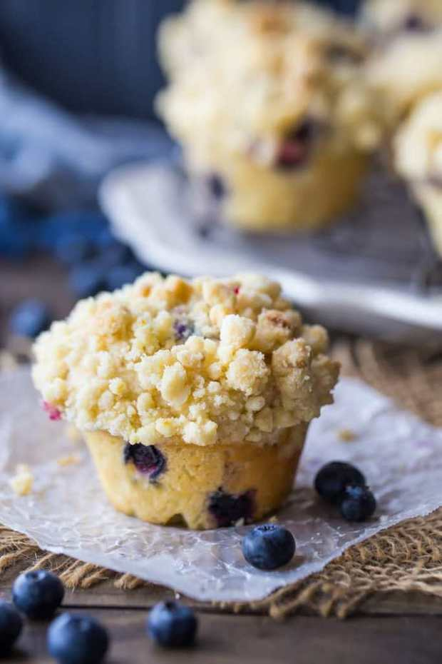 The most perfect blueberry muffin recipe ever! These muffins are light and moist, studded throughout with sweet berries, and sprinkled with a crunchy, buttery streusel crumb topping. They're quick and easy to make, so whip up a batch for breakfast or brunch!
