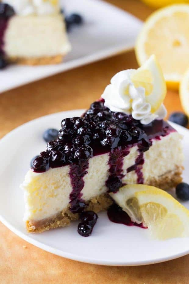 This Lemon Cheesecake with Blueberry Compote is ridiculously creamy & bursting with fresh spring flavors.
