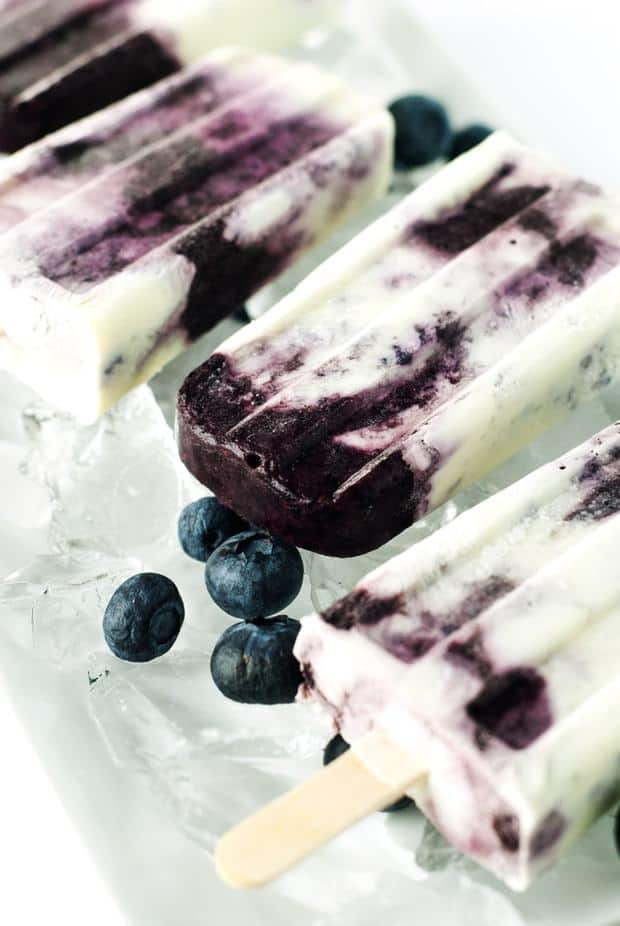 What I really love about these popsicles is that there are very few ingredients, and they whip up in just minutes. All you have to do is pop them in the freezer for a few hours and bam! time for yum! Ready to make some blueberries & cream popsicles? I sure hope so!